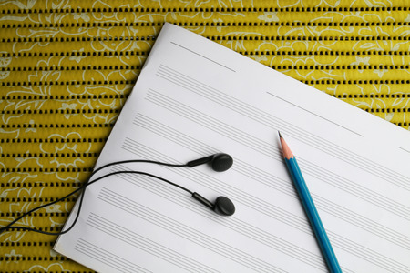 earphone: There are tools for  writing song such as earphone pencil and staff sheet. Stock Photo
