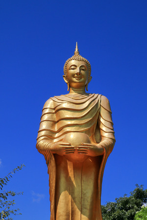 buddha image: The large buddha image holding an alms bowl in the public temple in Thailand. Stock Photo