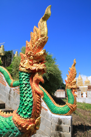 usually: The sculpture king of nagas usually decor at the stair in public temple of Thailand.