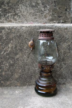 The old oil lamp is on the floor.Not using.
