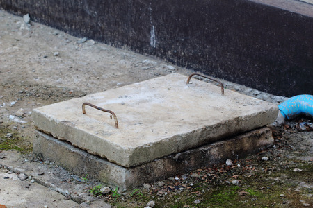 cesspool: Concrete cover for the septic tank.
