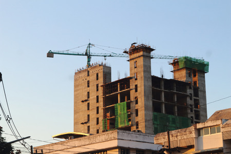 under construction building with clearly blue sky in the evening. photo
