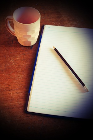 office tool: cup of drink and office tool on the table. Stock Photo