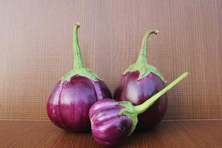 Purple Eggplant on wooden background photo