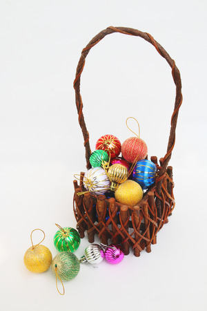 christmas ball in basket on white background photo