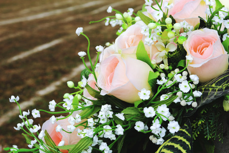 floristry of artificial roses and baby