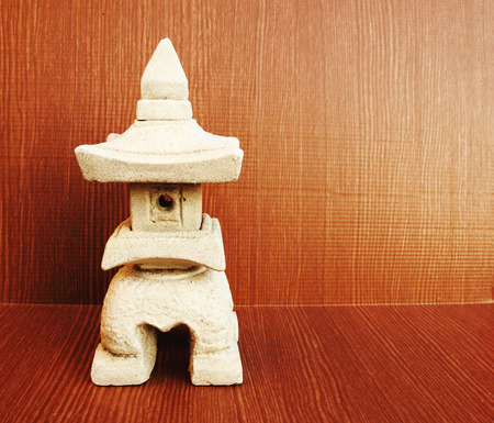 asian gardening: sculptuer of house with a Chinese style roof use for gardening.