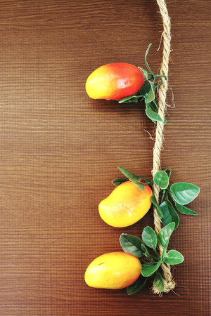 image of artificial mango on wooden background photo