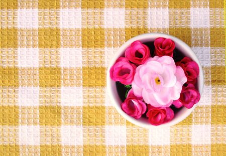 artificial roses in bowl for decoration table. photo