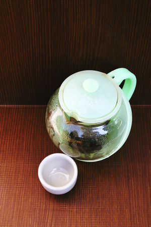 teakettle: image of teakettle and teacup.teakettle made from plastic and glass. Stock Photo