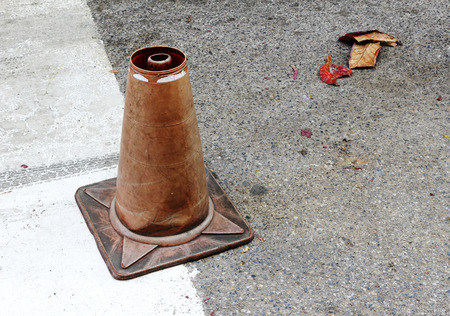 ole broken traffic cone on the road photo