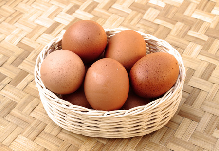 Many fresh eggs are in the basket photo