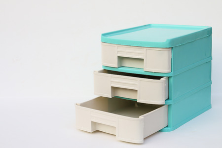 drawer: green plastic drawer which have three drawer on white background Stock Photo