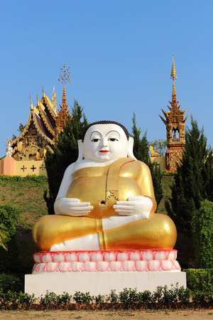 buddah: the larg statue of happy buddah in the public temple in Thailand