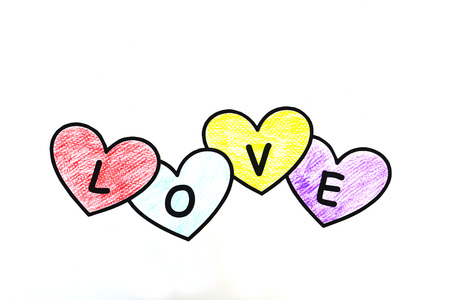 Four heart paper painting are arrange in word love. Stock Photo