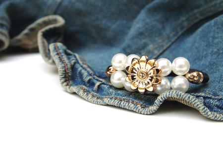 bangle: pearl bangle is puting on jean fabric