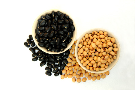 mung bean: black bean and soy bean in ceramic bowl and pouring on white background Stock Photo