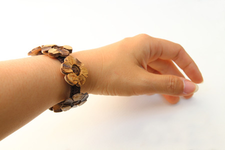bangle: bangle made from coconut shell on the wrist