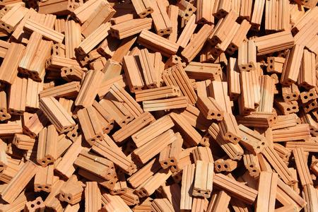 careless: pile of brick in daylight looks carelessly