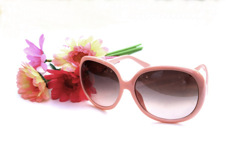 pink sunglasses decoration whith flower on white background photo
