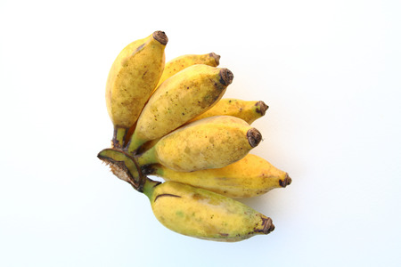 bunch of small banana on white background focusing at top view