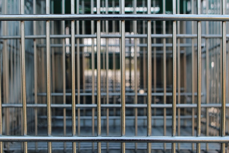 close up image at the steel cage of shopping cart photo