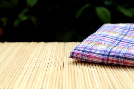 blur linen on bamboo matt focusing at corner of linen photo