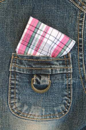 hanky: soft focus image of pink chessboard pattern handkerchief is in pocket of jeans shirt