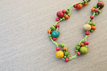 necklace from colorful wooden in soft focusing Stock Photo