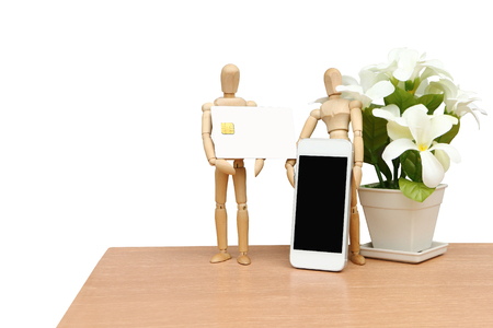 puppet doll holding mobile phone and credit card ,saved clipping path Stock Photo