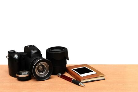 camera and notepad ,isolate white background