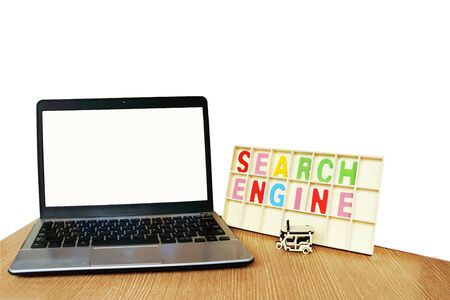 laptop and wooden word search engine  ,isolate white background