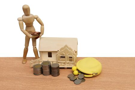 puppet doll ,house model and coins ,isolate white background
