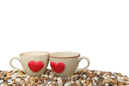 two cups of coffee on pebble ground ,isolated white background and saved clipping path Stock Photo