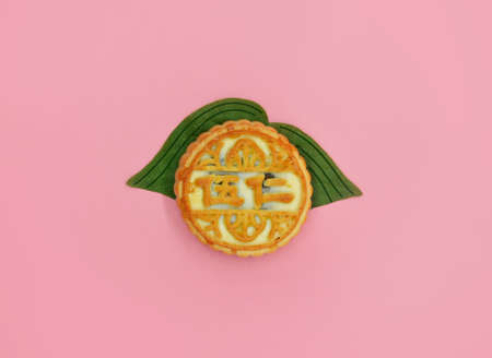 olive green: Moon cake on pink background