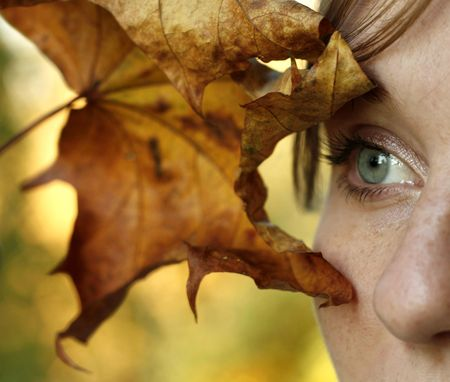 envisage: Young girl with autumn leaf Stock Photo