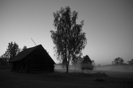 nordic country: Black and white landscape of Nordic autumn evening with country-house in fog.