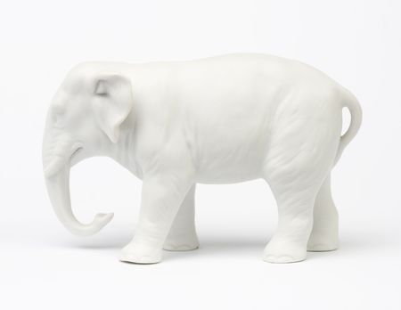 figurines: White elephant figure over white background.