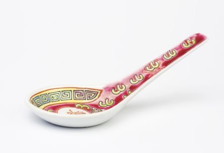 tableware: Chinese soup spoon over white background. Studio shot.