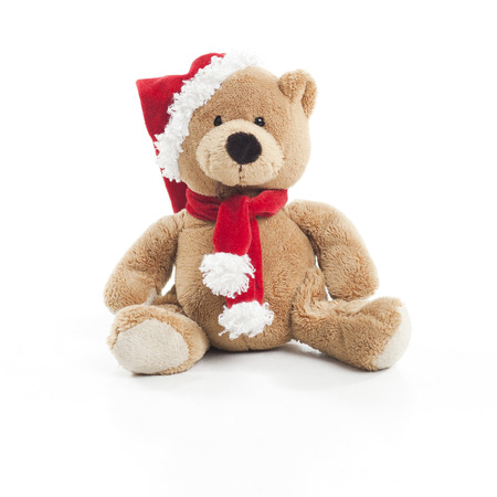 teddy bear background: Teddy bear with christmas hat and scarf over white background Stock Photo