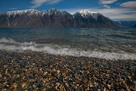 Russia. The South Of Western Siberia. Mountain Altai. Late spring on the shore of the lake Teletskoye. Stock Photo