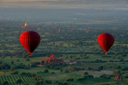 Bagan. Myanmar. 11/25/2016. Every morning at dawn, a dozen balloons, let's see, a bird's eye, a splendor of many ancient Buddhist temples of Bagan.