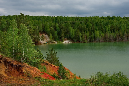 Russia. The South Of Western Siberia. Flooded quarry for copper mining, the increased content of which in the water gives it a blue-green color Imagens