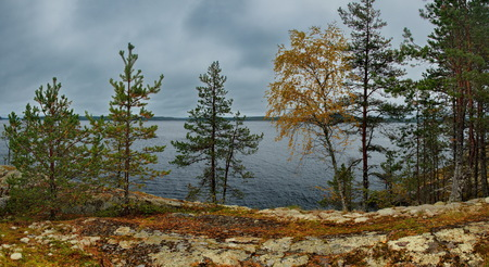 Russia. Karelia. Gloomy autumn on lake Ladoga Banco de Imagens - 119215963