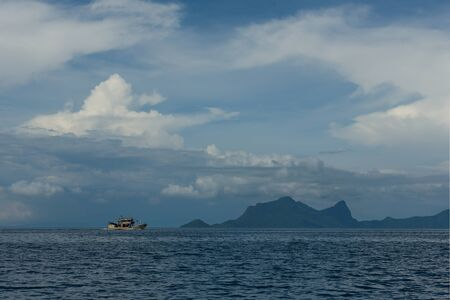 Malaysia East coast of Borneo island. 11/28/2018. Small boats with tourists there are daily numerous coral island, the world famous diving clubs.