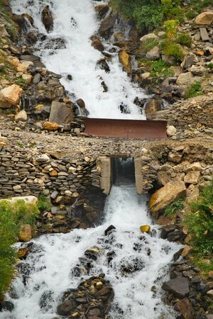 Central Asia. Tajikistan. Tributaries of the border river Panj are notable for numerous waterfalls and clean drinking water.