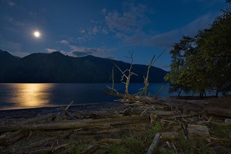Full moon at the end of summer. Russia, South Of Western Siberia, Altai Mountains. Altai state natural biosphere reserve, Bele cordon in the South of lake Teletskoye.