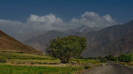 Central Asia, Tajikistan. View from the right coast of the border river Panj on the Pamir mountains in Afghanistan.