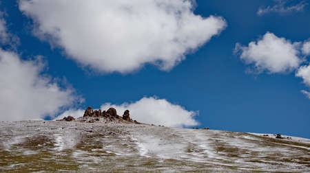 Western Mongolia. The clouds on the snow-covered high-altitude steppes seem very low due to the high altitude (2500-3000m above sea level).