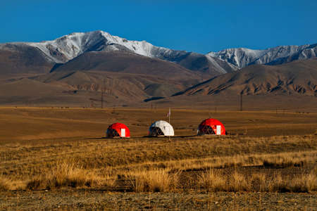 Kosh-Agach. Russia. October 04, 2019. A tent research complex in the Chuya River valley surrounded by snow-capped mountains in the south of the Altai Mountains.